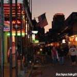 Bourbon street at sunset.  Notice the amount of lights and people.  This is really early for Bourbon street as it gets busier as the night goes on.