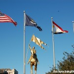 The Louisiana, New Orleans, and American flags flying together.