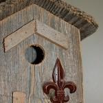 Fleur de lis on birdhouse