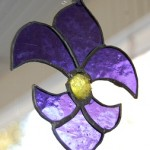 Purple stained glass fleur de lis
