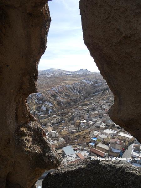 Peeping through a rock formation in Capadoccia